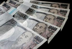Illustrative picture shows Japanese 10,000 yen bank notes spread out at an office of World Currency Shop in Tokyo