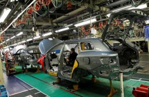A man works on the production line at the Toyota factory in Derby